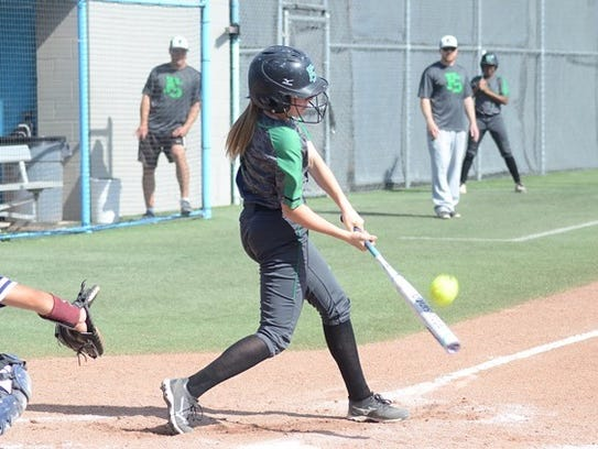 Farmington's Kailee Williams makes contact at the plate
