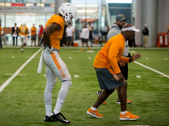 Tennessee defensive backs coach Charlton Warren, right, coaches player Justin Martin (8) during practice on Thursday, April 6, 2017.