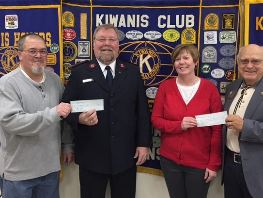 Golden K Kiwanis member Don Mueller, left, presents