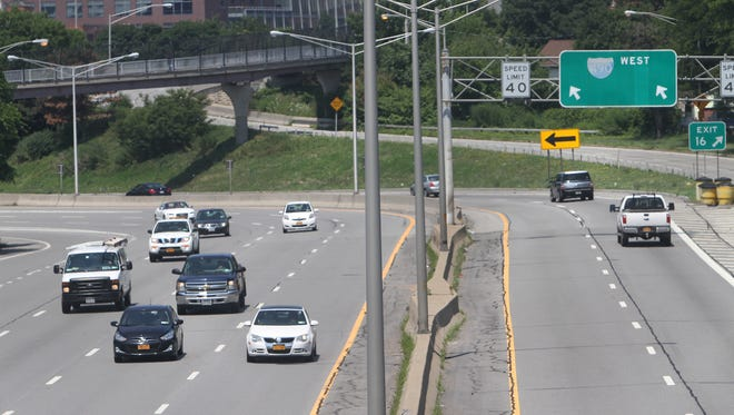 Traffic on Interstate 490 near Alexander Street in Rochester last summer. The state DMV keeps extensive records on every driver in New York.