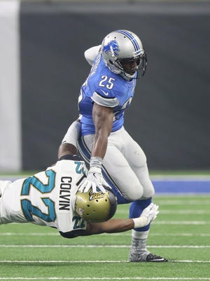 Lions running back Theo Riddick is tackled by Jacksonville Jaguars cornerback Aaron Colvin.
