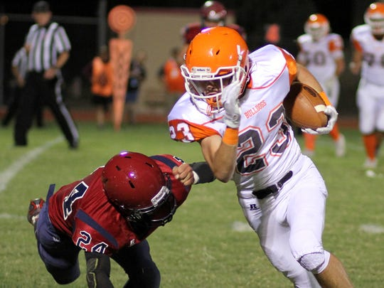 James Carroll (24) lunges in an effort to prevent an Artesia score.