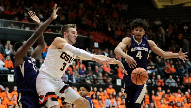 Washington's Matisse Thybulle (4) defends as Oregon State's Tres Tinkle (3) passes the ball during the first half of an NCAA college basketball game in Corvallis, Ore., Saturday, Feb. 10, 2018.