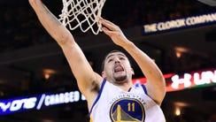 Golden State Warriors guard Klay Thompson (11) shoots