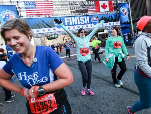 Kelly Newell, 36, of Bloomfield Twp lifts her hands