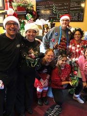 Holiday Attire – The staff at Just Rennie's spent the last day before the holidays decked out in their holiday finest, or better stated, their holiday shiniest. Posing from left are Kevin Forbes, Narda Jones, Katie Voegerl, Maggie Ethridge, Kinsey Peralta, Doug Rennie and Amber Lorde.