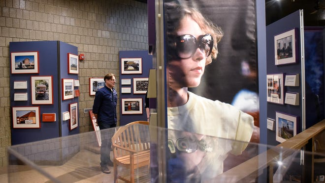 "Stearns History Museum collections curator Eric Cheever walks through a portion of the traveling Smithsonian exhibition ""Searching for the Seventies: The DOCUMERICA Photography Project,"" Thursday, May 25, at the museum in St. Cloud."