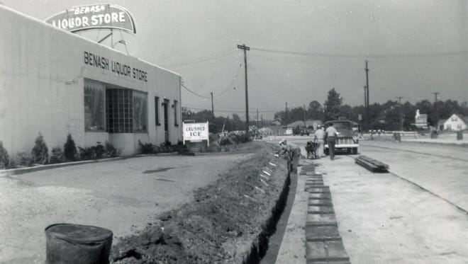 A 1947 photo of the Benash Liquor Store located at Route 38 and Church Road in Cherry Hill.  The store's 67-year-old sign was originally on top of the store, but was moved to the street level in the early 1970s.   An alleged drunk driver took out the landmark sign early Friday morning.  06.23.14 (Photo provided)