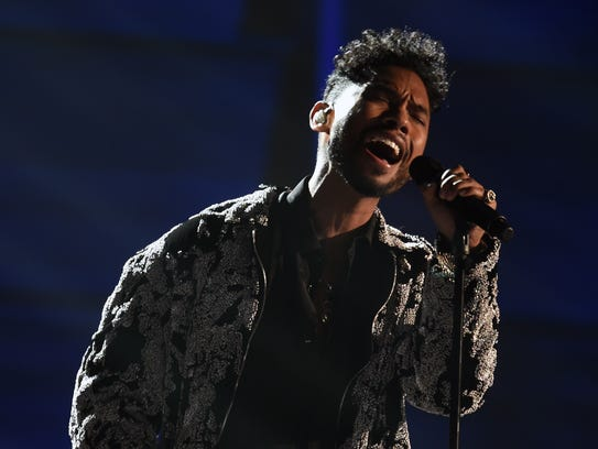 Miguel channels Michael Jackson during the Grammy Awards.