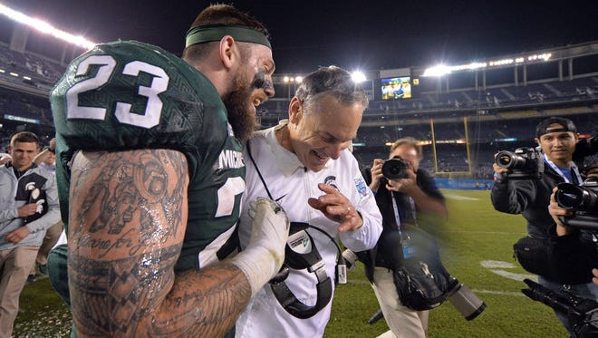 Michigan State Spartans head coach Mark Dantonio (center) and linebacker Chris Frey (23) celebrate a 42-17 win over the Washington State Cougars in the 2017 Holiday Bowl at SDCCU Stadium.