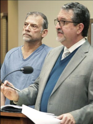 Bruce Burnside makes an initial court appearance with retained attorney John Hyland, right, in Madison on April 10, 2013. Burnside was bishop of the South-Central Synod of Wisconsin of the Evangelical Lutheran Church of America and was on his way to a sermon when he struck and killed Maureen Mengelt in Sun Prairie.