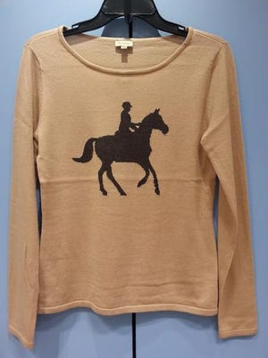 Just you and your steed, silhouetted in brown against a tan sweater … and the world. Cremieux, $79, Dillard's, The Mall at Green Hills, 2126 Abbott Martin Road, Nashville. www.dillards.com; 615-297-0971