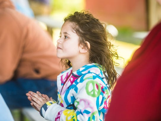 Mary Oliver, 5, of Biglerville, watches the Carroll