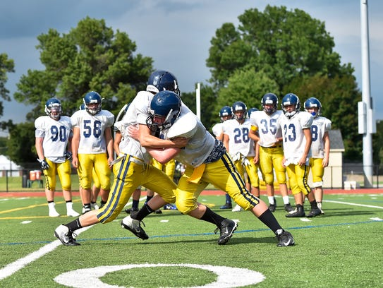 Greencastle's football team run drills during practice