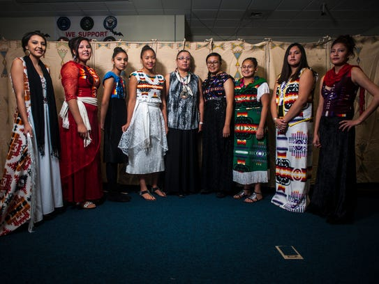 Belinda Bullshoe, center, who has attended Couture Fashion Week in New York City, displays her designs at the High Noon Indigenous Fashion Show at the Paris Gibson Square Museum of Art Thursday, March 15.