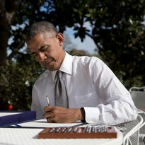 President Barack Obama signs the bill H.R. 2 Medicare Access and CHIP Reauthorization Act of 2015 in the Rose Garden of the White House in Washington on April 16. On Iran, Medicare, education and trade, Republicans and Democrats have come together to make deals, and that's something rarely seen lately.
