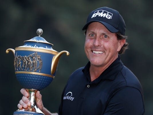 Phil Mickelson, of the U.S., poses with his Mexico Championship trophy at the Chapultepec Golf Club in Mexico City, Sunday, March 4, 2018. (AP Photo/Eduardo Verdugo)