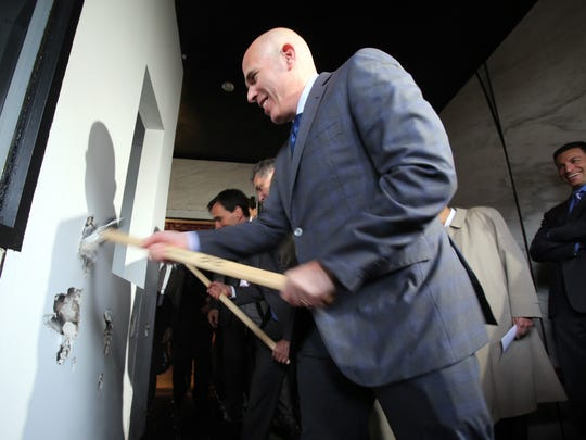 Scott Rechler, chief executive officer and chairman of RXR Realty, uses a sledge hammer at the groundbreaking ceremony for the 28-story mixed-use tower at the former Loews Theater site in New Rochelle.