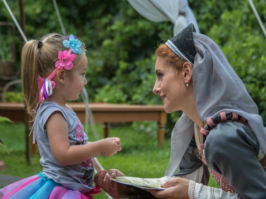Hundreds of brightly costumed performers entertained
