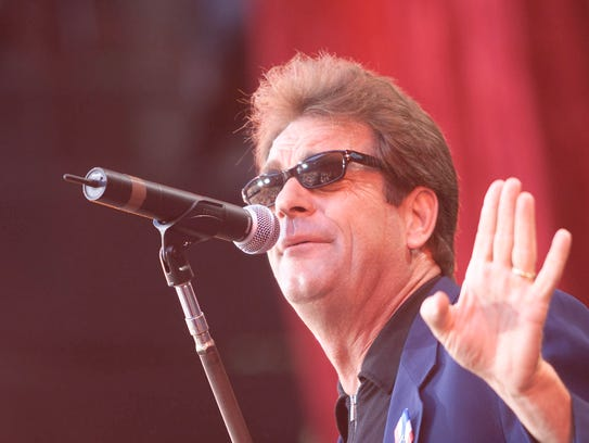 Huey Lewis onstage performing at the United We Stand: