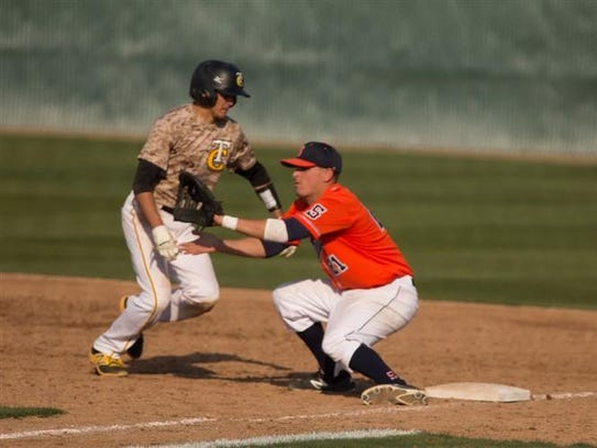 COS first baseman Oscar Reyes hauls in a pass from
