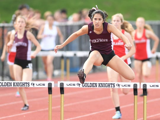 First day of Bergen County Track Championships at Old Tappan High School on Friday, May 11, 2018. Katherine Muccio, of Ridgewood, on her way to finishing first in her division of the 400IH.