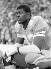 Tennessee senior Reggie White, a candidate for the prestigious Lobardi Trophy that goes to the nationÕs outstanding lineman, rests on the sidelines during the Vols 34-24 victory over Vanderbilt before 93,426 fans at Neyland Stadium in Knoxville Nov. 26, 1983.