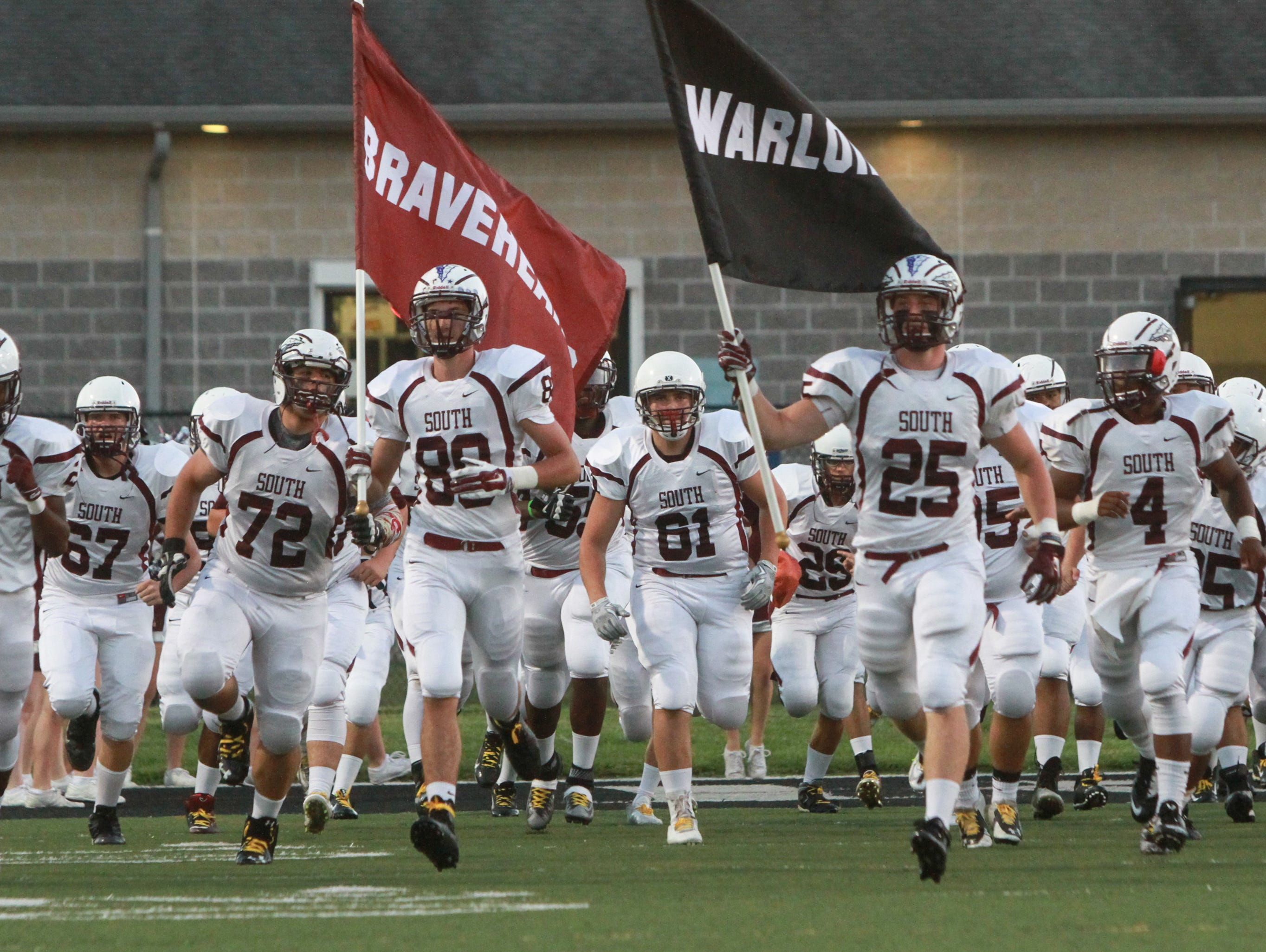 Toms River, NJ TRS enters the field. Toms River High South at Toms River High School East. 091815 - 3252147