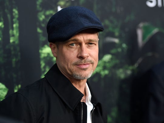 "Brad Pitt arrives at the Los Angeles premiere of ""The"