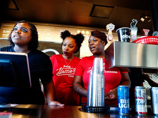 Hattie B's Hot Chicken servers (left to right) Danielle Bell, Cedrika Hewing, and Kiva Love help patrons during the restaurant's soft opening of their new Memphis location.