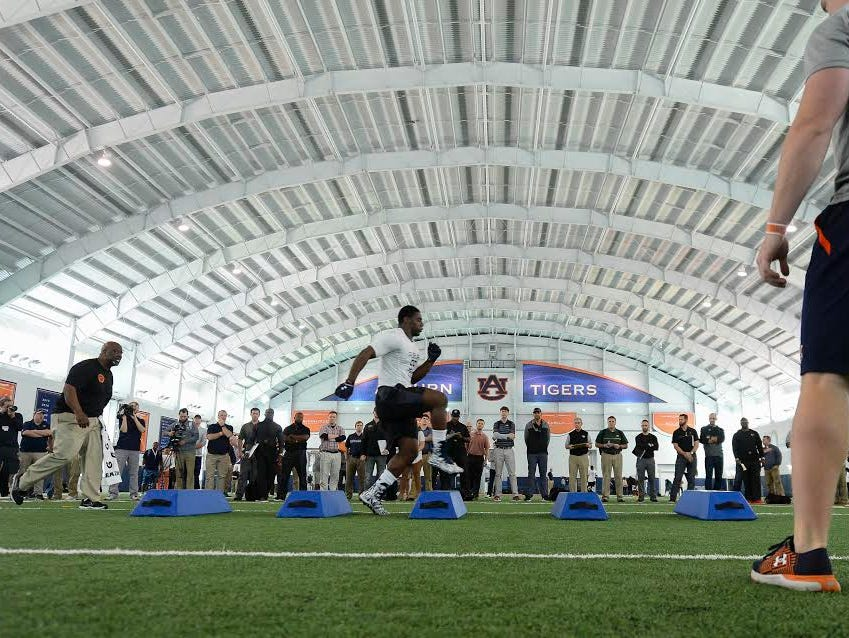 Auburn defensive end Carl Lawson doing individual drills during his Pro Day workout at Auburn on March 10, 2017.