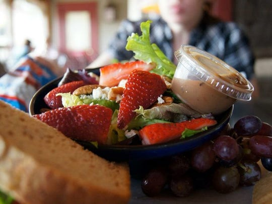 Salads offer a healthy aspect at Acorn Market. Many salads are topped with fresh fruit and light dressing but can also be paired with various meats.