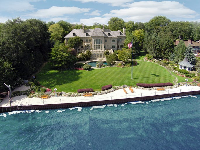 The Lake St. Clair-facing rear view and back yard of the Art Van Elslander estate in Grosse Pointe Shores.  The estate of the Art Van Furniture founder and his wife, Mary Ann, is up for auction. It was initially listed for $15.9 million on the Grand Estates Auction Co. website.