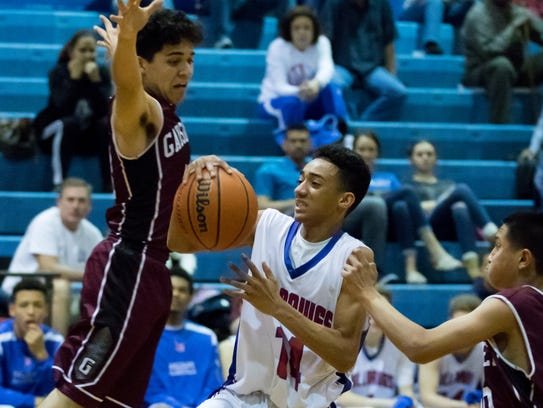 Las Cruces High's Shae Hernandez tries to find a hole