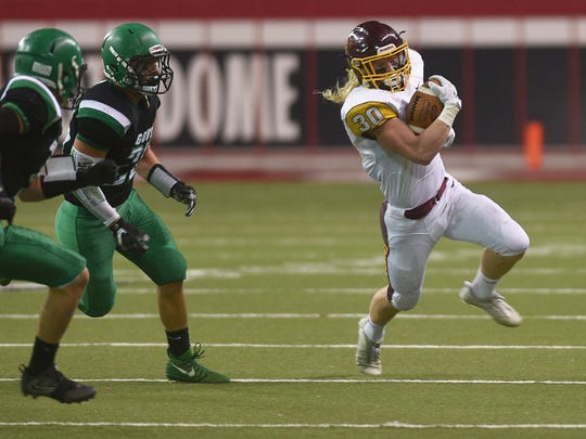 Harrisburg's Jack Anderson runs past Pierre defense during the game Friday, Nov. 10, at the DakotaDome in Vermillion.