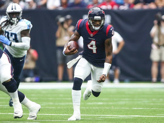Houston Texans quarterback Deshaun Watson (4) runs