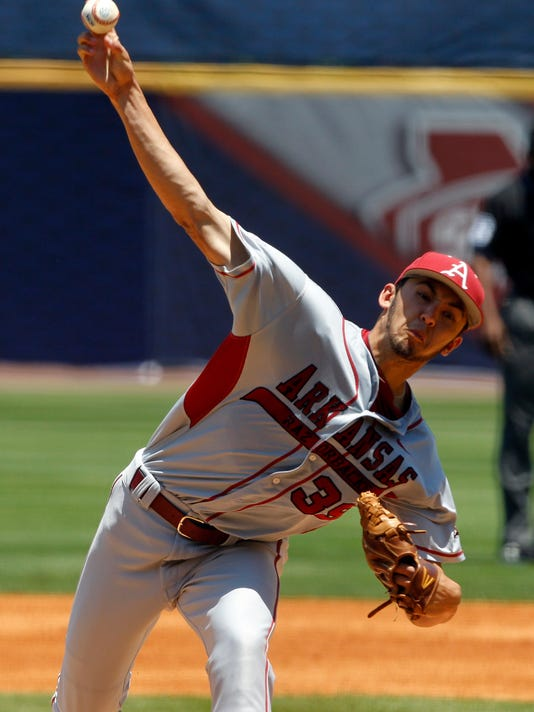 FILE - In this May 21, 2014 file photo, Arkansas' Chris Oliver (39) pitches against Mississippi during the first inning at the Southeastern Conference NCAA college baseball tournament  in Hoover, Ala. Despite an overhauled starting pitching staff this season, Arkansas _ which led the country in staff ERA a year ago _ has continued to be among the pitching leaders this season. (AP Photo/Butch Dill, File)