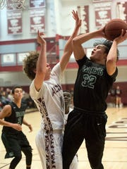 Webb's Chase Ridenour attempts to score while defended