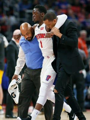 Reggie Jackson is helped off the court during the second half of the Pistons' 107-83 win over the Pacers on Dec. 26, 2017, at Little Caesars Arena.