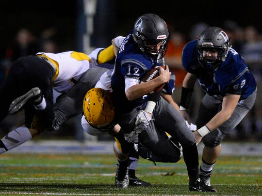 In this 2015 photo, Dallastown's Michael Sparks is pulled to the ground by Red Lion's defense during last year's rivalry game at Dallastown. The Lions beat the previously unbeaten Wildcats 26-0 that evening. On Friday, Red Lion is now the  undefeated team welcoming the 7-2 Wildcats.