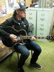 Bonamassa spent several minutes playing Amos Arthur's 1960 Gibson l4-CES during a recent visit to the Fountain Square music store.