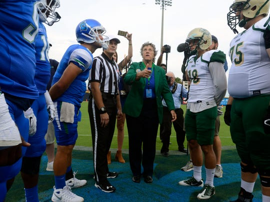 University of West Florida President Judy Bense does the coin toss Sept. 10, 2016, during UWF's first home football game at Blue Wahoos Stadium.
