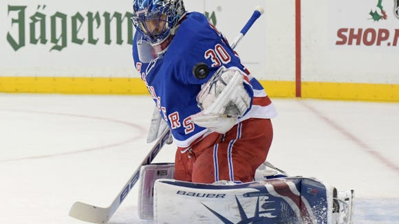 New York Rangers goalie Henrik Lundqvist prepares to glove the puck during the first period of the team's NHL hockey game against the Carolina Hurricanes on Friday, Dec. 1, 2017, at Madison Square Garden in New York. (AP Photo/Bill Kostroun)