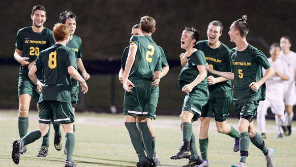 The Reynolds soccer team celebrates after Matthew Kennedy