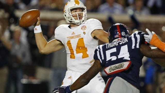 Tennessee quarterback Justin Worley (14) is pressured by Mississippi defensive end Carlos Thompson (54) as he attempts a pass in the first half of an NCAA college football game in Oxford, Miss., Saturday, Oct. 18, 2014. (AP Photo/Rogelio V. Solis)