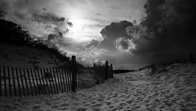 """""""Sunset, LBI,"""" by Colin Seitz, is one of the black and white photographs featured in the Exhibition."""