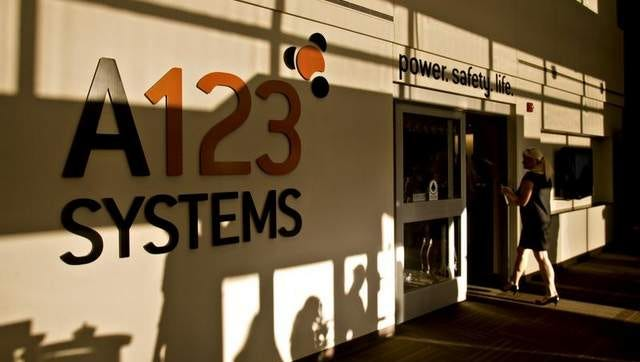 A sign sits on display at the new A123 Systems lithium ion automotive battery manufacturing plant in Livonia, Michigan, U.S., on Monday, Sept. 13, 2010. A123 Systems Inc. climbed as much as 13 percent after opening the largest U.S. factory to produce electric car batteries in Michigan, where 250 workers have been hired and up to 3000 will be employed as production increases, according to the White House. The company received $249 million in federal stimulus grants from the Obama administration last year.