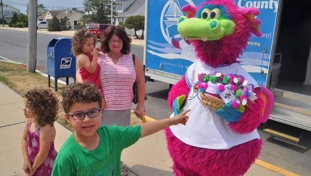 Sean Mars, 7, Lavallette, points to Ocean County Library mascot Sparks at the Upper Shores branch July 29. His mother Patricia and sisters Isabella, 4 and Mikayla, 5, joined him at the event.