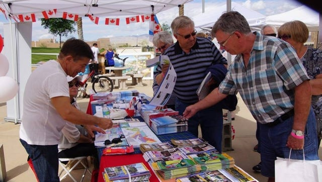 Attendees pause at one of the vendor booths at the Canada/Snowbird Festival in 2015 at the University California Riverside Palm Desert Campus. The 2016 Canada/Snowbird Festival will be Feb. 27 and 28 at the Agua Caliente Resort Casino and Spa in Rancho Mirage.