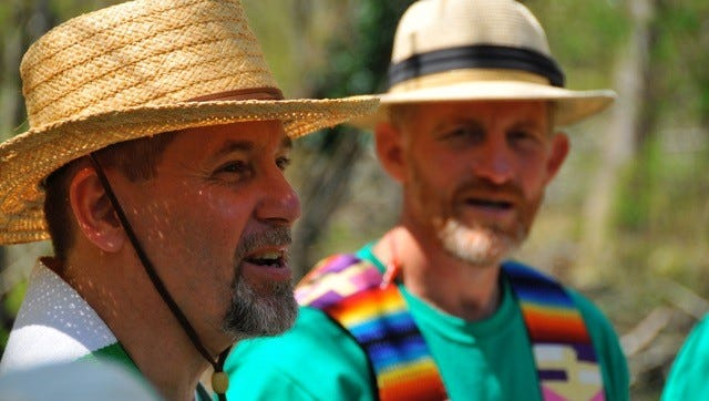 """""""Fr."""" Michael Mernaugh, pastor of Anamanchara Faith Community in Crescent Hill, is shown with """"Fr."""" Raymond Schafer, another community leader, at a past Earth Day service at Bernheim Forest."""